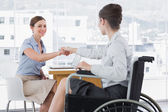 Businesswoman shaking hands with disabled colleague — Stock Photo