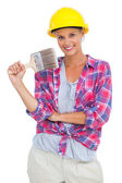 Attractive handy woman holding a brush and smiling at camera — Stock Photo
