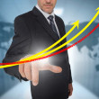 Businessman touching red and yellow growth lines with world map — Stock Photo