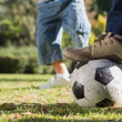 Child kicking the ball — Stock Photo