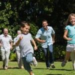 Happy multi generation family racing towards camera — Stock Photo #29445201