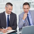 Stock Photo: Serious businessmen analyzing application