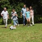 Happy multi generation family playing football — Stock Photo