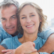 Smiling man hugging his wife from behind — Stock Photo #29445463