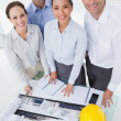 Smiling architect team posing while working together — Stock Photo