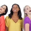 Diverse young women laughing at camera — Stock Photo