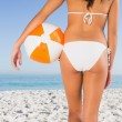 Back of womans perfect body holding beach ball — Stok fotoğraf