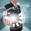 Businessman touching futuristic circle interface — Stockfoto