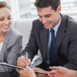 Businessman signing contract while his partner is looking at him — Stock Photo