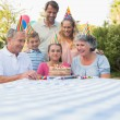 Happy extended family celebrating little girls birthday — Stock Photo
