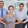 Stock Photo: Smiling work team posing together looking at camera
