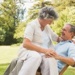 Smiling mature couple in park — Stock Photo
