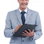 Joyful businessman holding clipboard and taking notes — Stock Photo