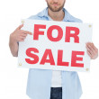 Trendy model holding for sale sign — Stock Photo #29446365