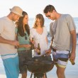 Cheerful young friends having barbecue together — Stock Photo #29446441