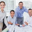 Cheerful architects posing while anaylzing plans together — Stock Photo