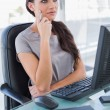 Pensive businesswoman in front of her computer — Stock Photo