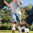 Boy kicking the football — Stockfoto