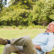Stock Photo: Happy man relaxing