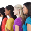 Stock Photo: Diverse young women looking in same direction
