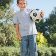 Young boy holding football — Stock Photo