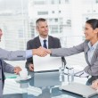 Stock Photo: Smiling business people shaking hands