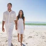 Beautiful couple holding hands and walking towards camera — Stock Photo