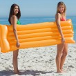 Stock Photo: Two pretty friends holding air mattress