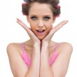 Cheerful young model with hair curlers — Stock Photo #29448999