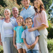 Stock Photo: Happy family and grandparents in the park