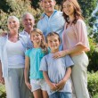Happy family and grandparents in the park — Stock Photo