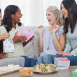 Friends offering gifts to woman during party — Stock Photo