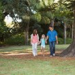 Family walking in a park — Stock Photo