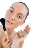 Seductive model holding make up — Stock Photo