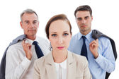 Serious employee posing with her work team — Stock Photo