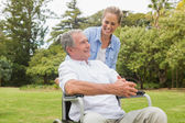 Laughing man in wheelchair and daughter talking — Stock Photo