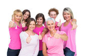 Positive women posing and wearing pink for breast cancer — Stock Photo