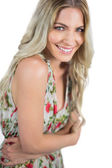 Smiling seductive blonde wearing flowered dress posing — Stock Photo
