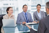 Work team interviewing experienced man — Stock Photo