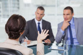Brown haired woman talking to her interviewers — Stock Photo