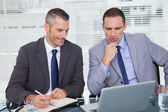 Serious businessmen analyzing application — Stock Photo