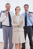 Cheerful businesswoman posing with her work team — Stock Photo
