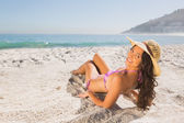 Smiling attractive young woman in pink bikini sunbathing — Stock Photo