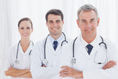 Smiling doctors posing together — Stock Photo