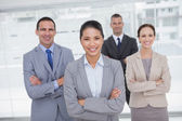 Cheerful work team posing crossing arms — Stock Photo
