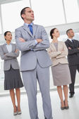 Unsmiling work team posing while looking in the same direction — Stock Photo