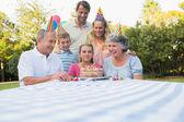Happy extended family celebrating little girls birthday — Stock Photo