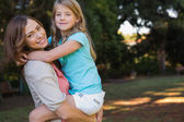 Young mother holding her daughter — Stock Photo