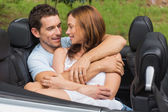 Couple in love cuddling in the backseat — Stock Photo