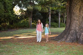 Mother and daugther walking in a park — Stock Photo